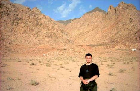 encampment area of Mount Sinai with blackened peak